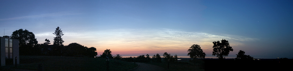 Fig. 1:Noctilucent cloud display seen from Kühlungsborn, Germany, on June 24, 2005 while the sun is about 8 degrees below the horizon. (courtesy, G. Baumgarten)